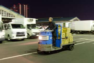 At the Tsukiji Fish Market, they move inventory using these tiny electric trucks!